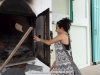 Samara fueling the wood drying furnace.  Outside Bangkok, Thailand.