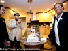 Franci, Obanilu and John .  About to cut the cake that Vivianne Cohen made for him