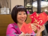 Kenna with her Chinese New Year's red envelopes