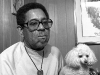 Dizzy Gillespie and his dog, Maestro watching a soap opera in his home in Englewood, NJ
